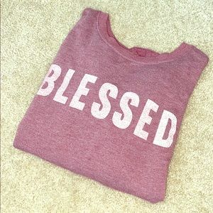 •Crew neck sweater that says BLESSED